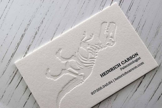 Cotton business card with digital black ink printing and blind debossing.