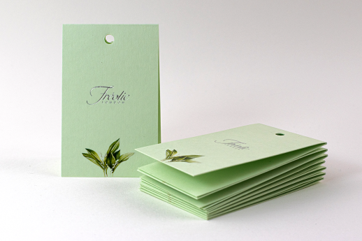 Swing Tags on Colorplan Pistachio with digital printing, silver metallic foil and folded.