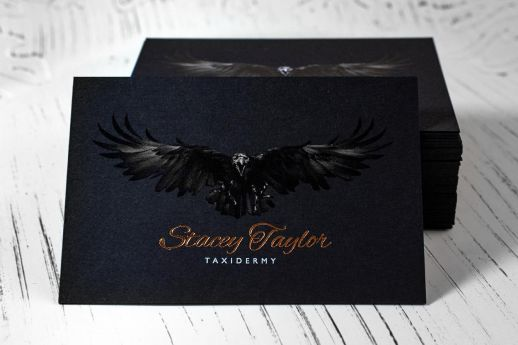Black Vanguard business card with CMYK + White ink printing + bronze foil stamp