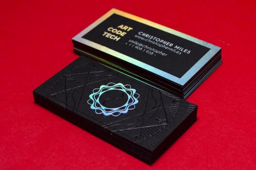 Ebony Black Colorplan business cards with black gloss, white gloss and holographic silver foil stamping.