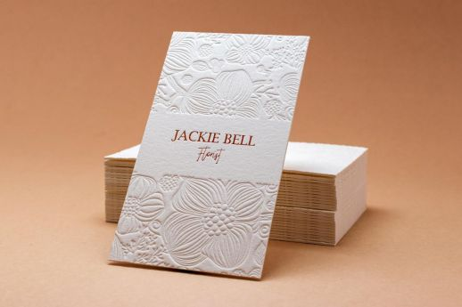 cotton business card with rose gold foil and blind debossing