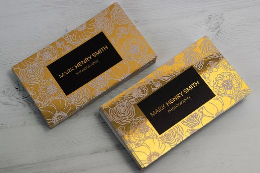 Reflective Metallic Gold business cards with digital black and white ink printing.