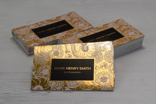 Mirror Reflective Metallic Gold business cards with digital black and white ink printing.