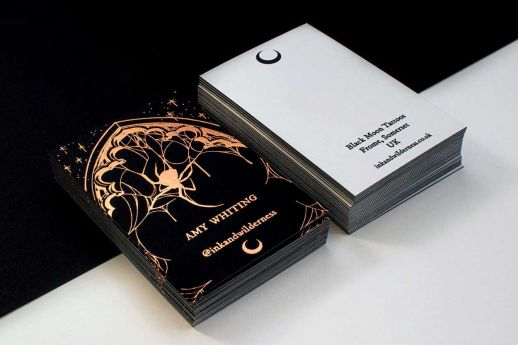 Vanguard black and white duplexed card with rose gold foil stamping and black ink printing.