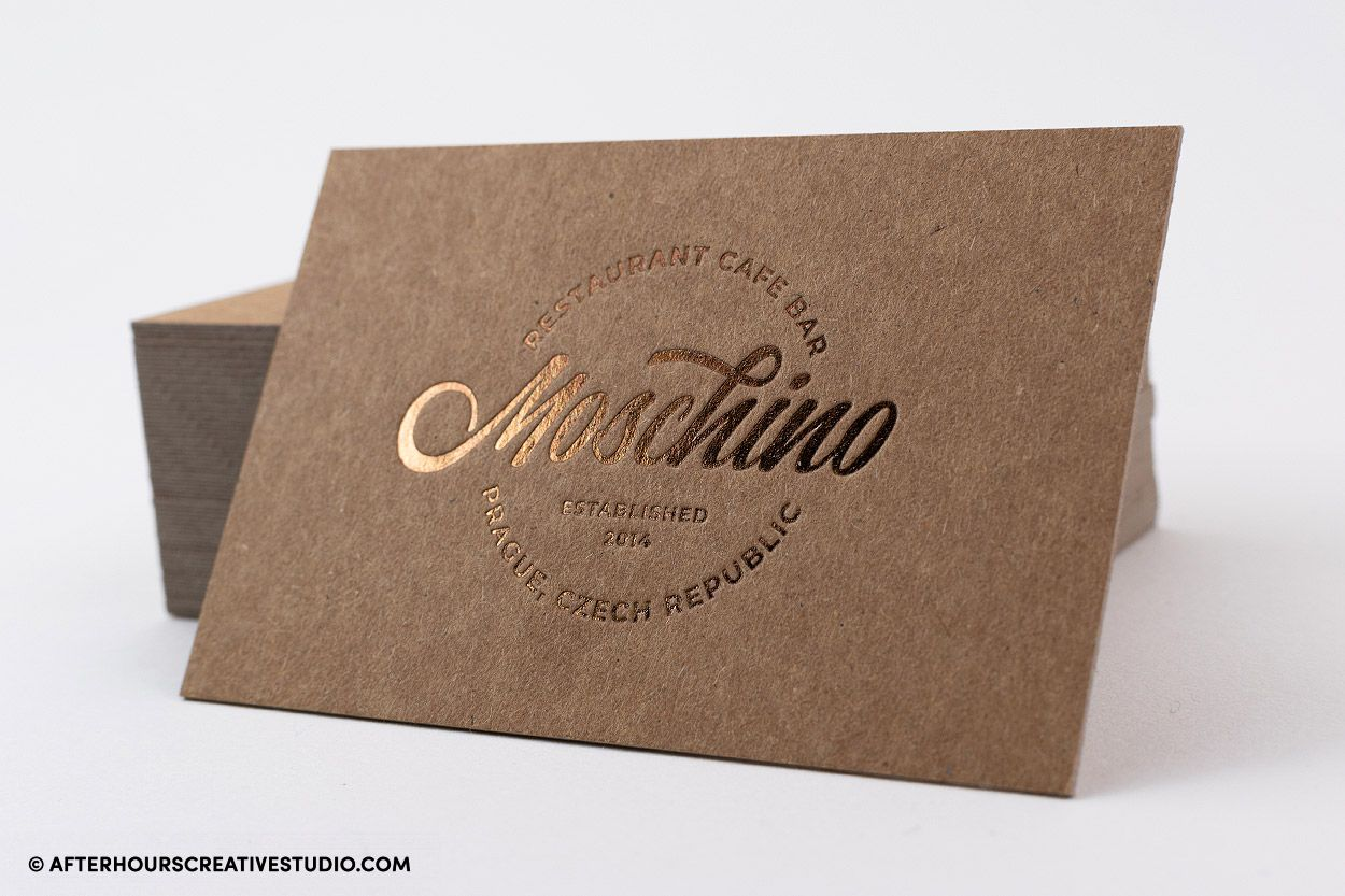 Kraft business card with metallic brown foil stamping.