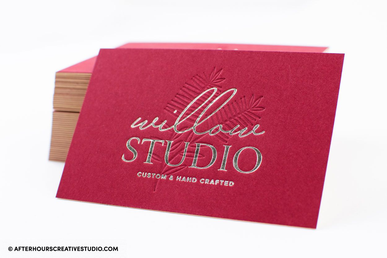 Senses Duplexed Business Cards 500gsm. Mellow Malbec/Antique Ivory with blind debossing and silver metallic foil.